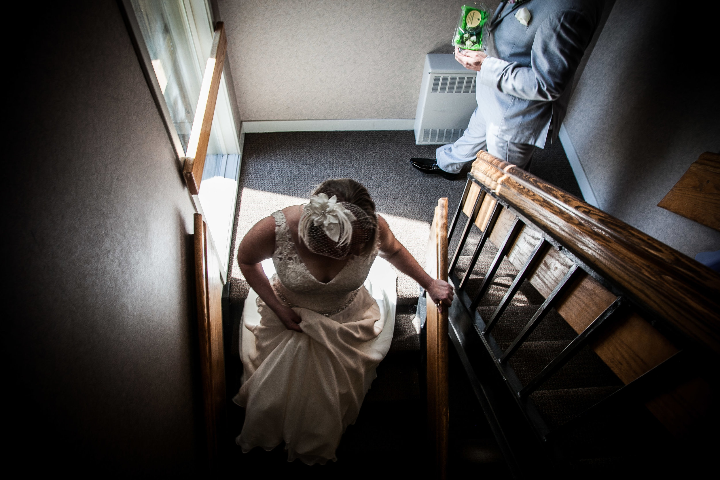 bride heading down stairs
