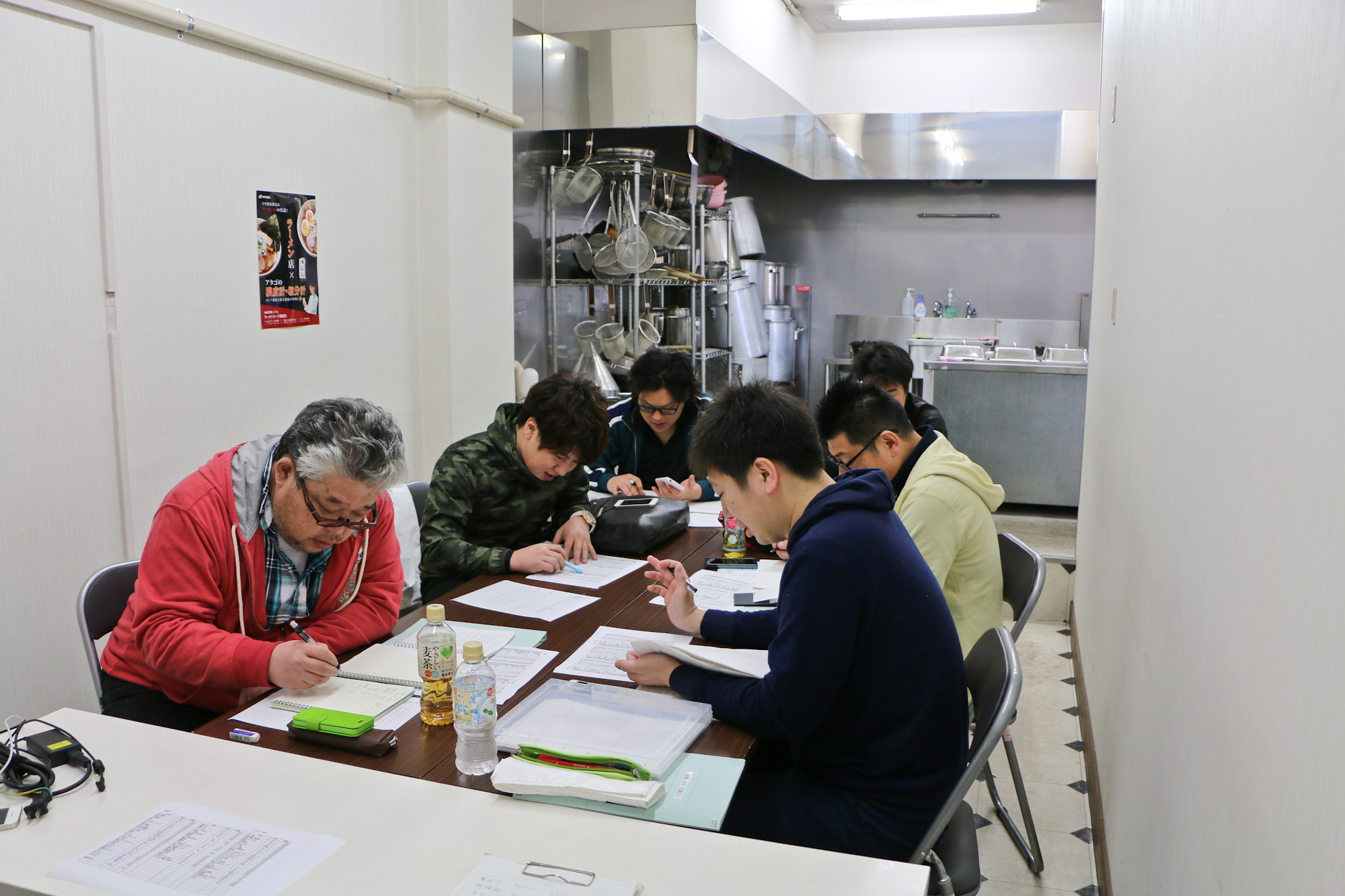 Ramen school students planning their ramen recipes.