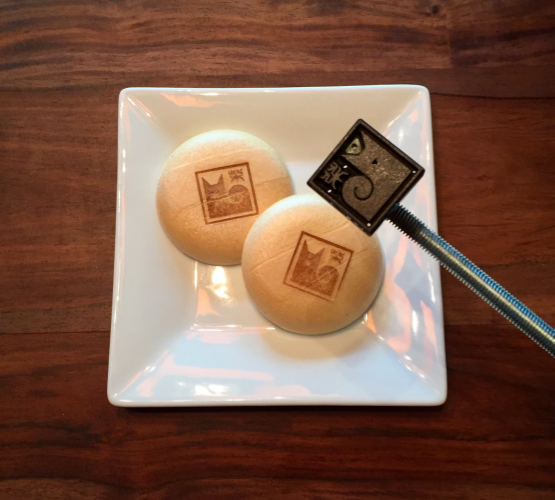 "Shiba Ramen Logo, Cast-Iron Brand .  We use a single Chinese character ( kanji ) saying only ""shiba.""  The text font and the logo itself evoke a traditional Japanese  hanko  stamp (see below).  Here with our Shiba Scream ice cream prototype (minus the ice cream)."