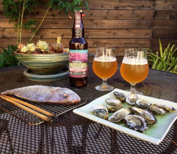 Dinner in the garden is pretty nice, too. Grilling tai snapper, with oysters and great beer.