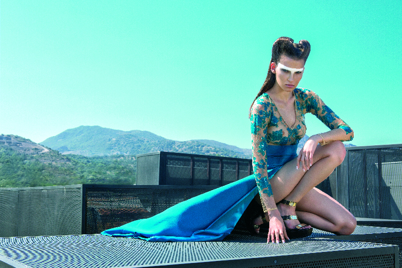 Teal blue high skirt and tulle body sitting.jpg