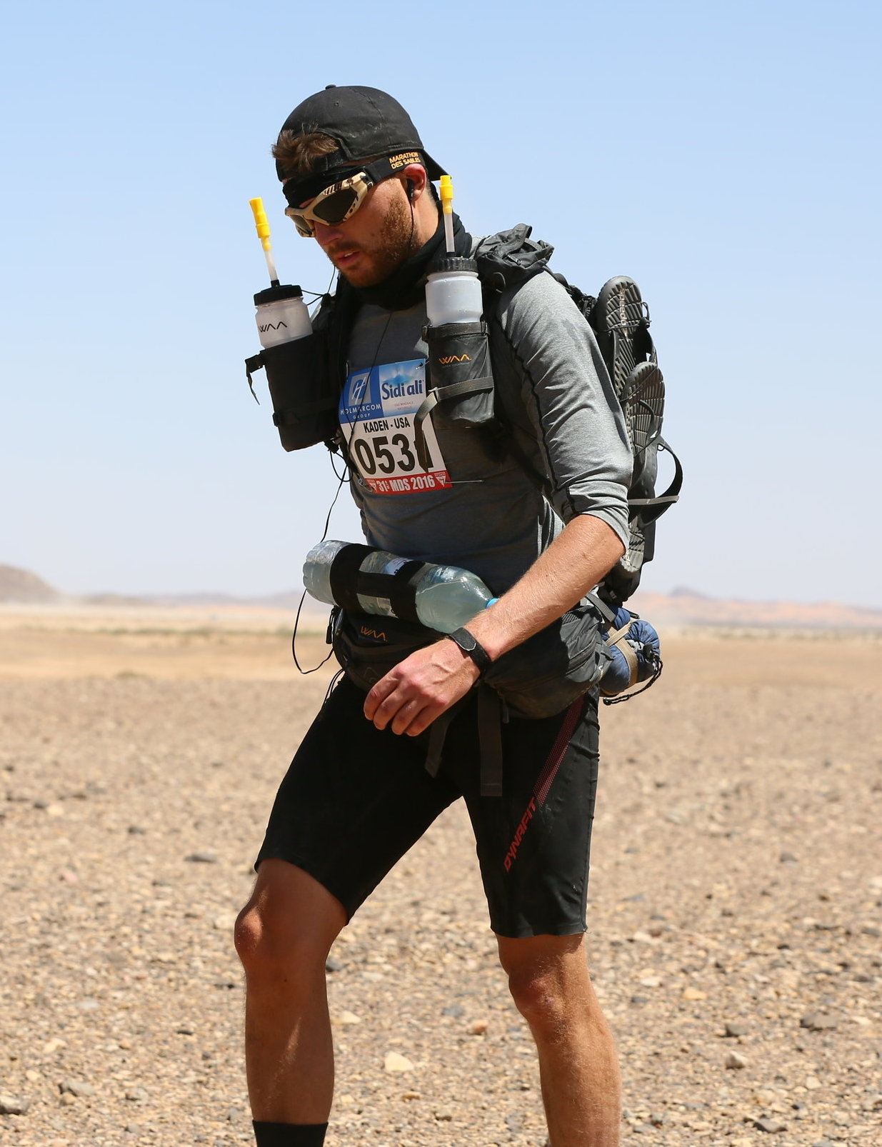 Slogging away on day 3. Runners carry everything they need to survive on their back the whole race. The only exception being a water ration.