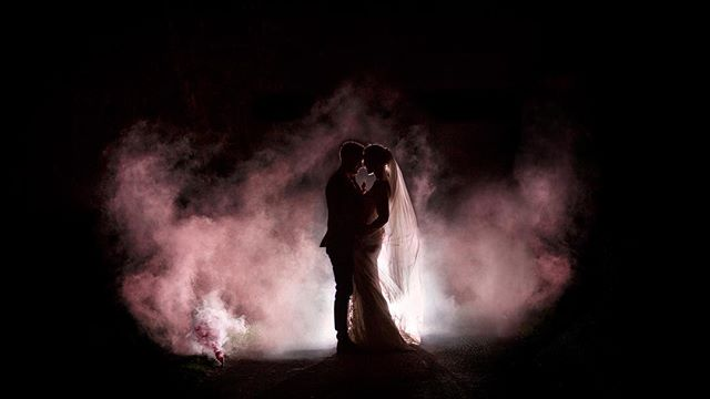 Smoke, backlight and a great couple make a great combination. #weddingphotography #smokebombphotography #creativephotography #theashesweddingvenue