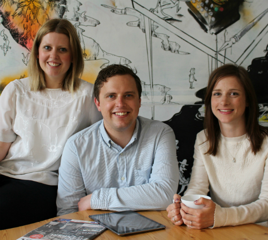 The Freshly Ground PR team sat in front of a wall drawing by Bath-based artist, Simon Spilsbury, at The Guild Hub in Bath, (L to R) Amy Brice, Sam Brice and Laura Parsons.