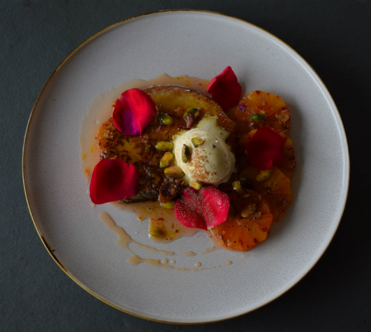 Eggy bread with caramelised blood oranges, rose and pistachios