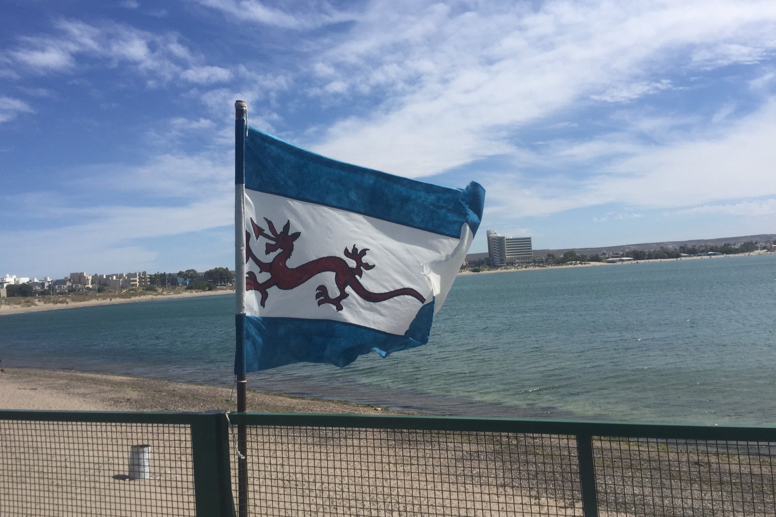The unofficial flag of Welsh Patagonia, combining the Welsh dragon and the blue stripes from the Argentinian flag.