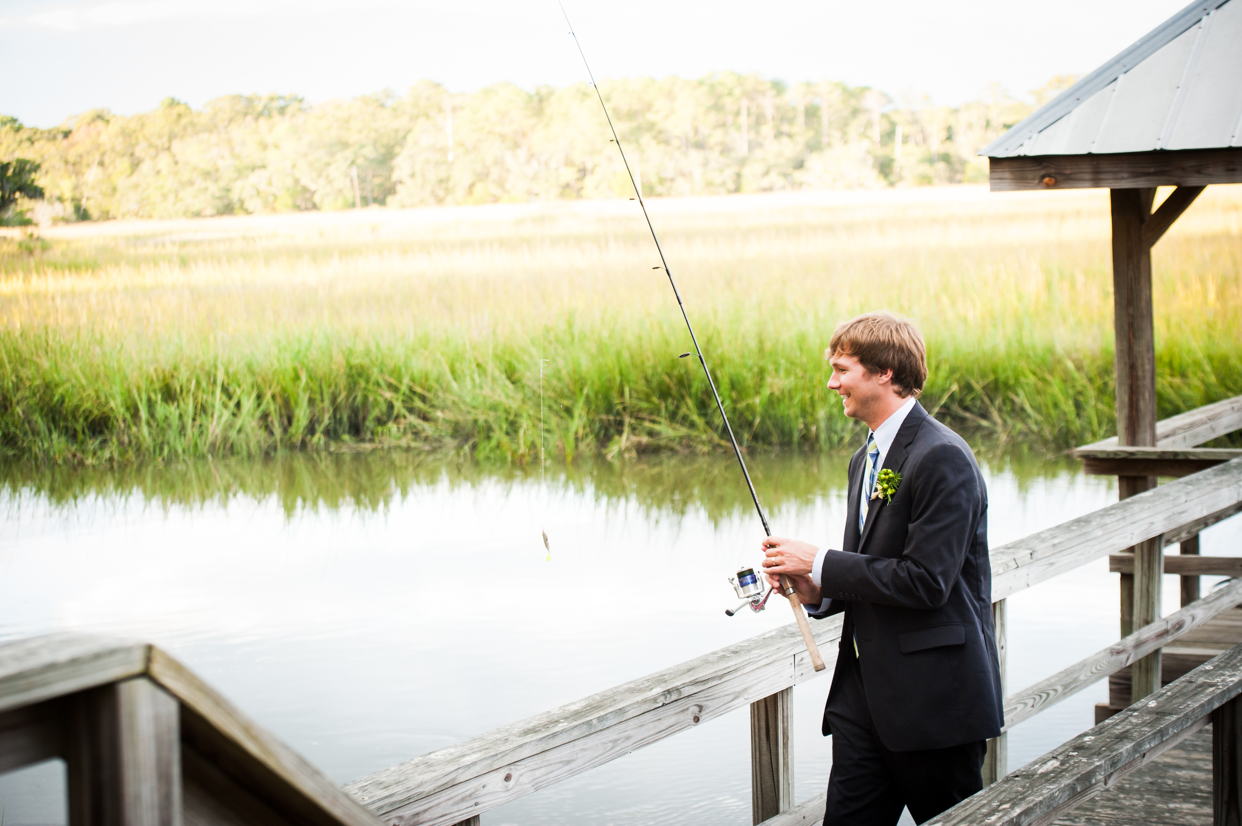 Groom fishing at Edisto Island Wedding
