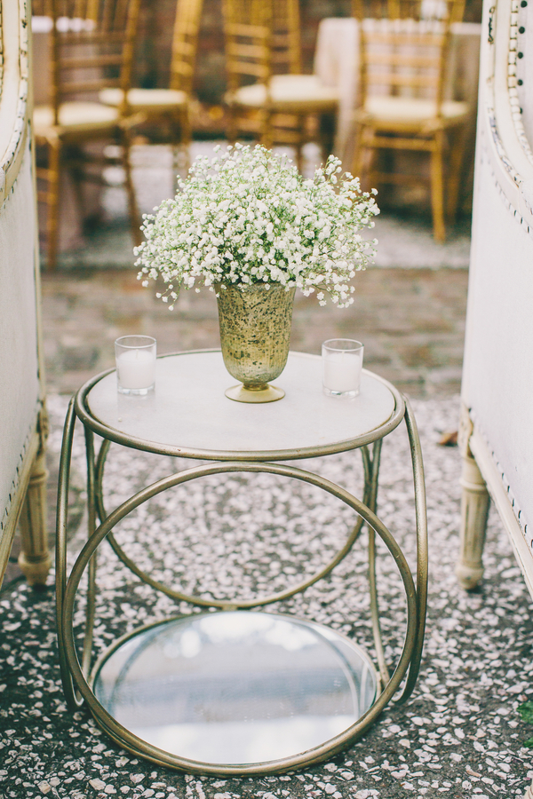 Gold End table with baby's breath centerpiece at William Aiken House wedding