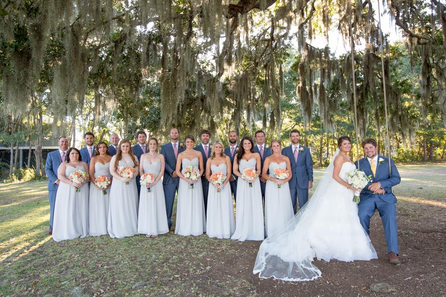 Light blue dresses and orange bouquets at Sunnyside Plantation wedding
