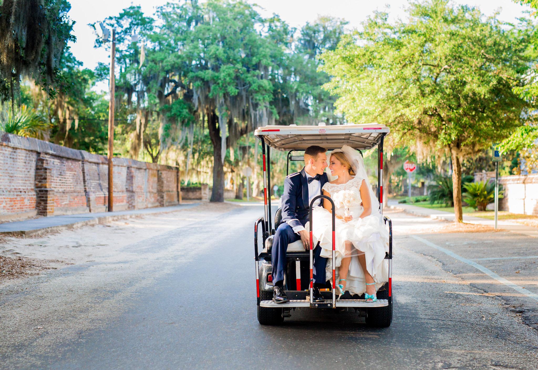 Bride & Groom's golf cart ride at Beaufort wedding