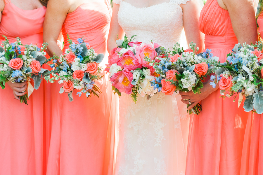 Coral bridesmaids dresses at Creek Club at I'On wedding in Charleston, SCby Alyona Photography
