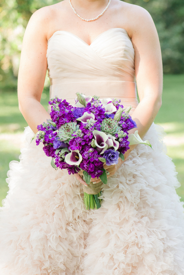 Purple wedding bouquet by Charleston Florist Wildflowers Inc.