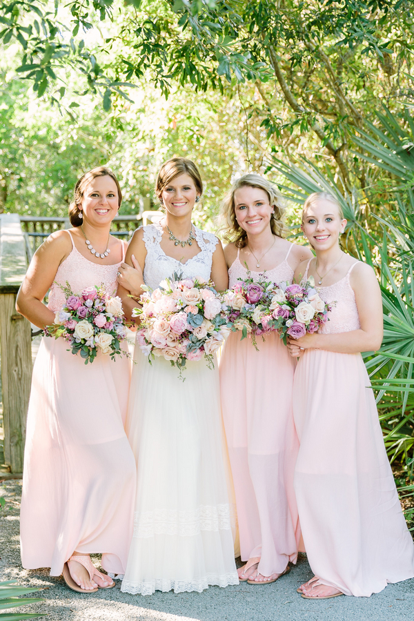 Bridesmaids in pale pink dresses at wedding in Myrtle Beach, SC by One Life Photography