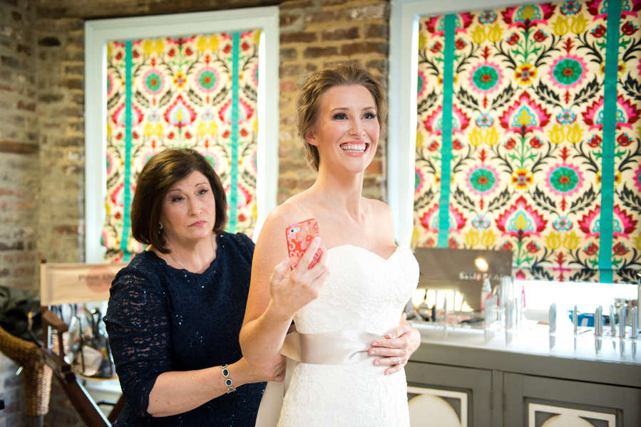 Bride at Pink Dot Beauty Bar for Charleston wedding hair and makeup