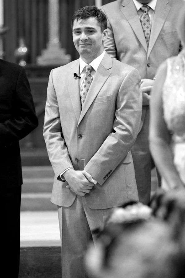 Groom watching Bride walk down the aisle at Charleston wedding ceremony