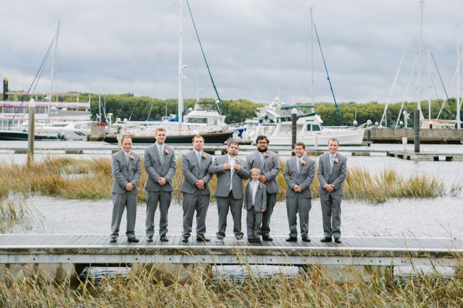 Groomsmen in grey suits at Charleston Yacht Club wedding by Stacy Howell Photography