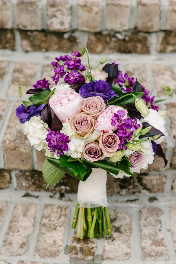 Purple Bouquet at Boone Hall Plantation wedding by Riverland Studios