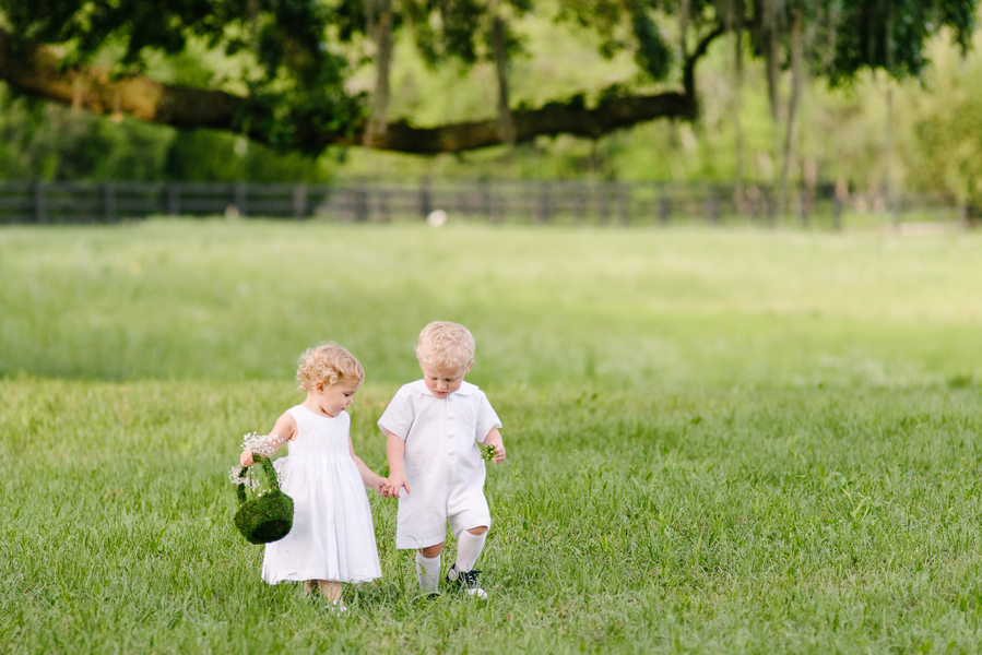 Flower girl and ring bearers at Charleston wedding ceremony at Boone Hall Plantation by Riverland Studios