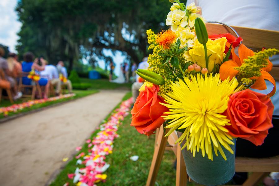 Yellow and orange aisle runners at Middleton Place wedding