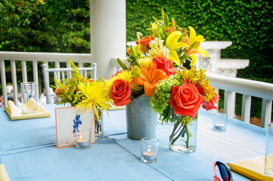 yellow and orange centerpieces at William Aiken House wedding in Charleston, Sc by inventivENVIRONMENTS
