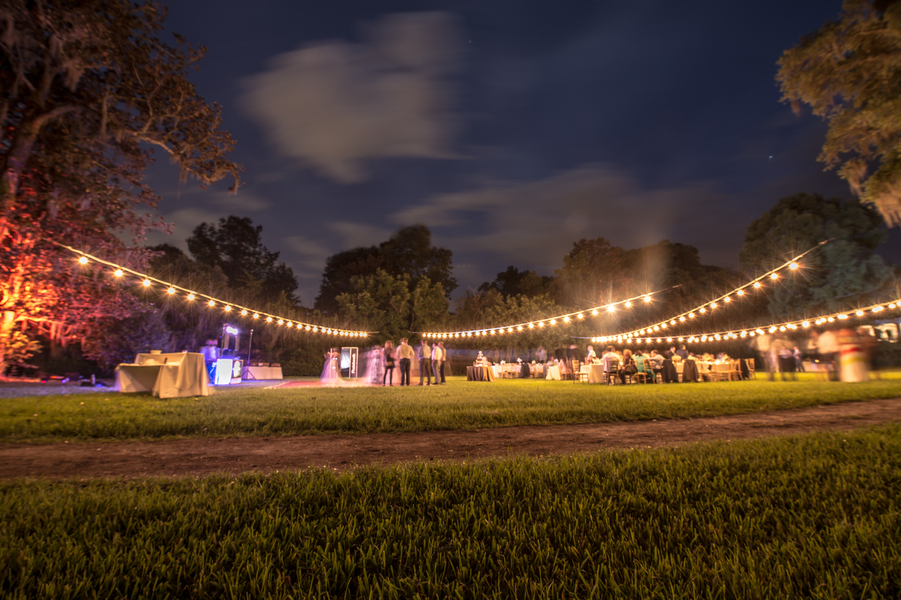 Open-air reception at Magnolia Plantation and Gardens wedding in Charleston, SC by CM Photography
