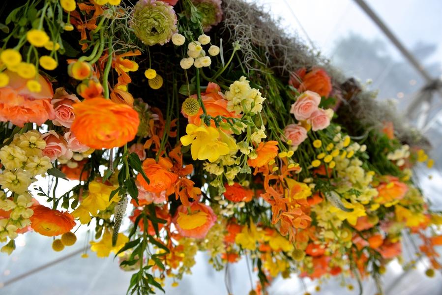 Orange and Yellow floral chandelier at Ford Plantation wedding in Savannah, GA by Donna Von Bruening