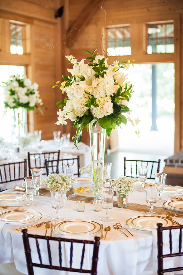 Tall white hydrangea and lily centerpiece by Keepsakes Florist at Pepper Platnation wedding