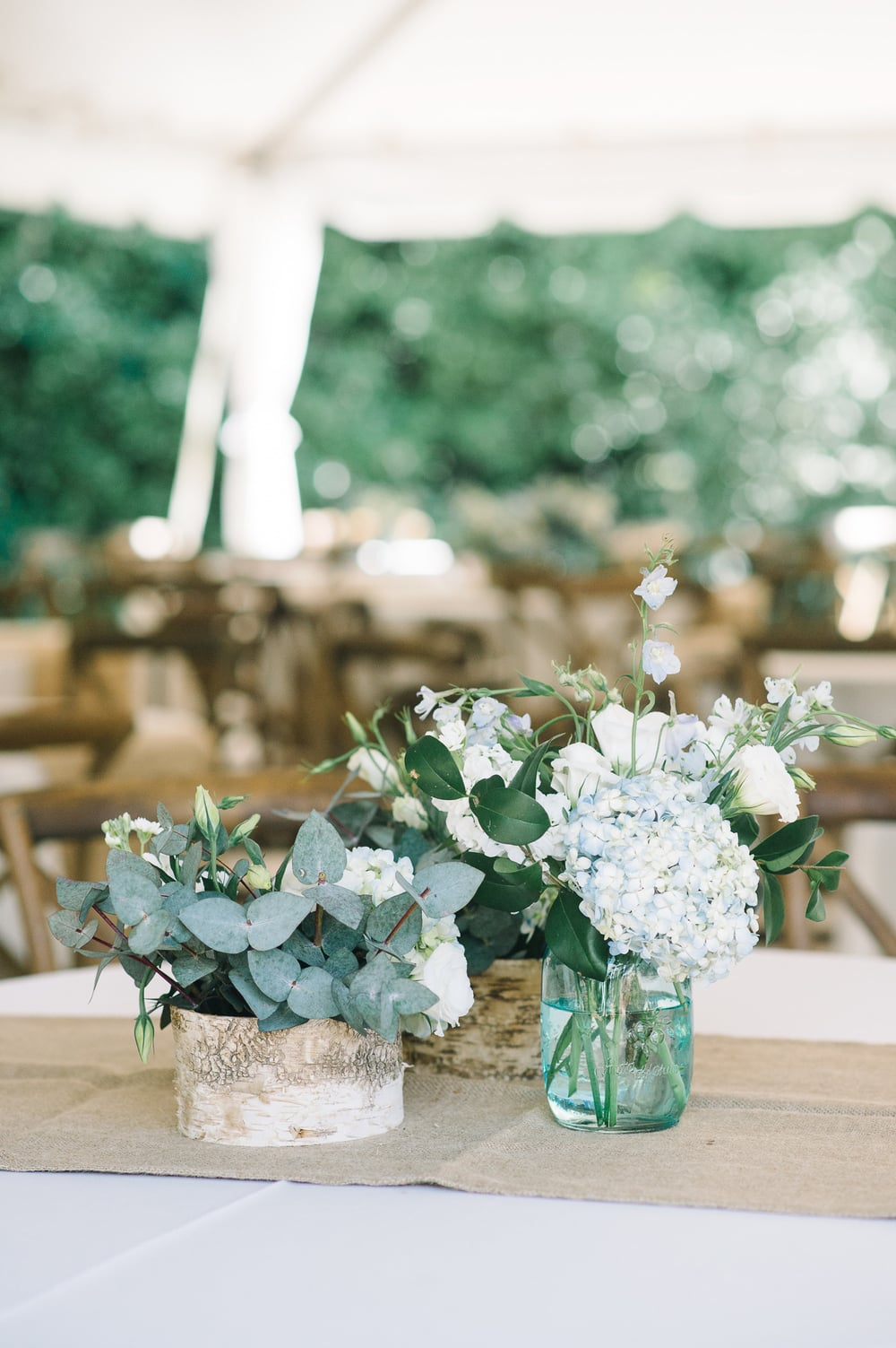 Rustic eucalyptus and blue hydrangea centerpieces at Charleston wedding at Legare Waring House