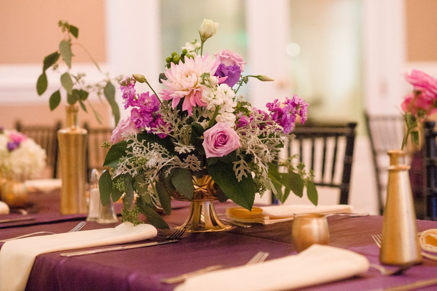 Purple and white centerpieces at Savannah wedding at Tybee Chapel
