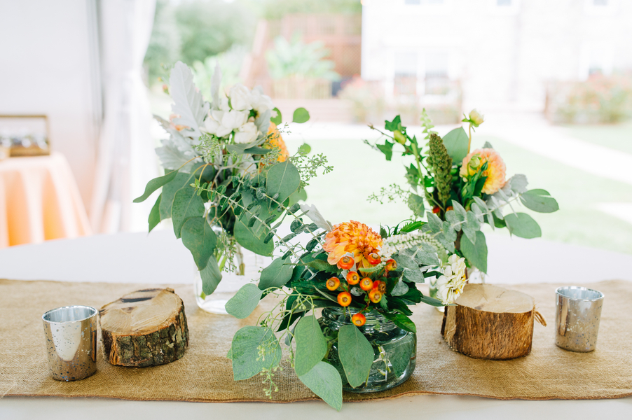 rustic Orange centerpieces at The Island House wedding by Riverland Studios