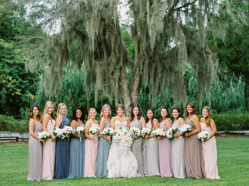 Long, Neutral bridesmaids dresses in cool tones by JoPhoto.