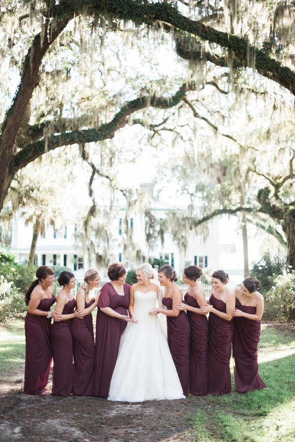 Cranberry bridesmaids dresses by Still Co. Photography.