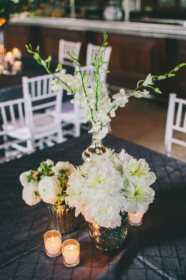 All white centerpieces at Collins + Kinsey's Harborside East wedding photographed by Hyer Images.