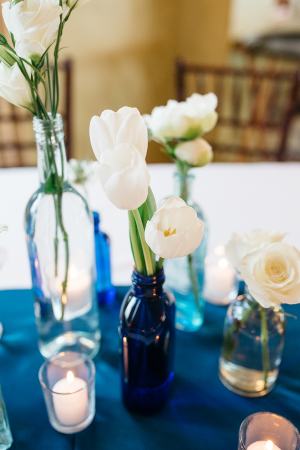 Bud vases with white blooms at Lowndes Grove wedding in Charleston, Sc by Branch Design Studio