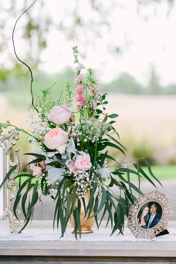 Whimsical garden rose centerpieces by Carolina Charm at Heritage Plantation wedding by One Life Photography.
