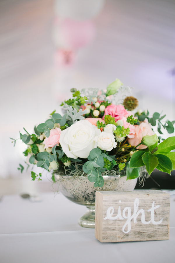 Centerpieces of white and pink roses, eucalyptus and scabiosa from First Bloom at Island House wedding in Charleston, Sc by Riverland Studio