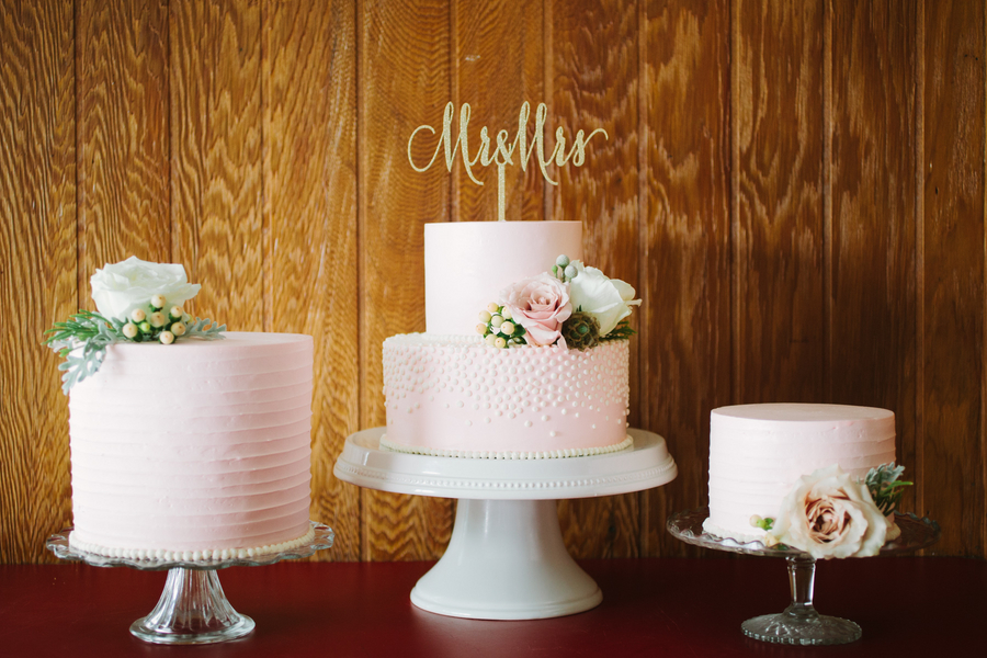 WildFlour Pastry created three adorable cakes with floral accents and a sparkly gold cake topper for Island House wedding by Riverland Studios