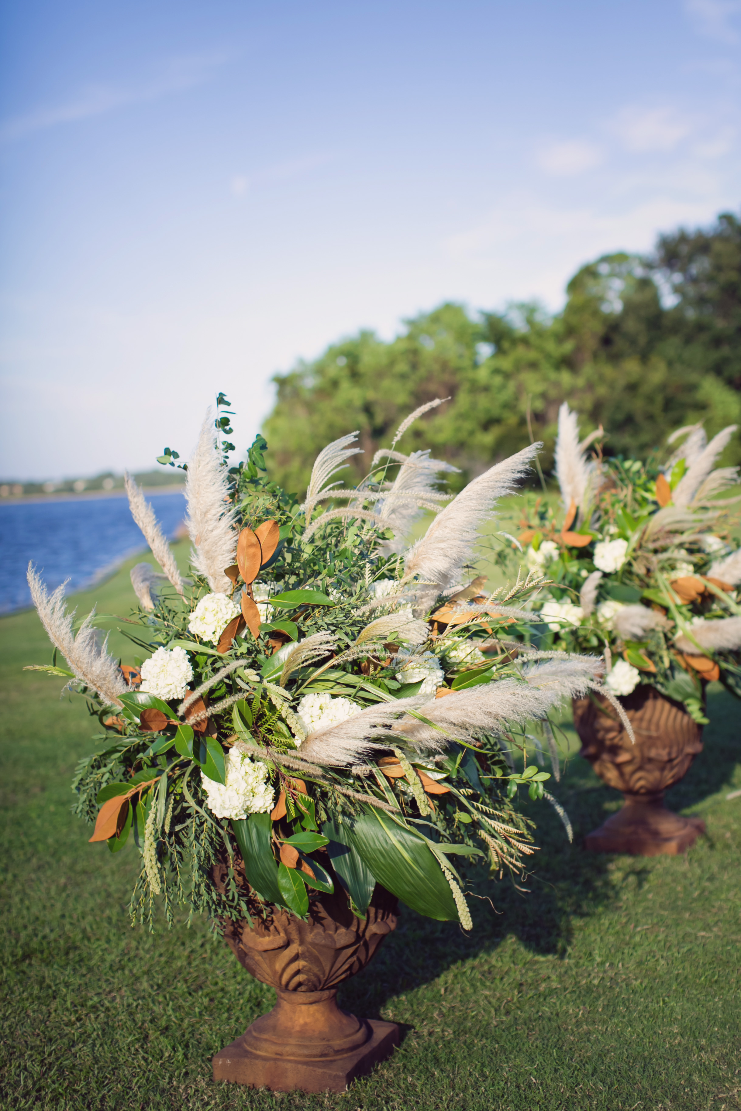 Wedding Ceremony Floral arrangements with white hydrangeas and magnolia leaves by Charleston florist Engaging Events