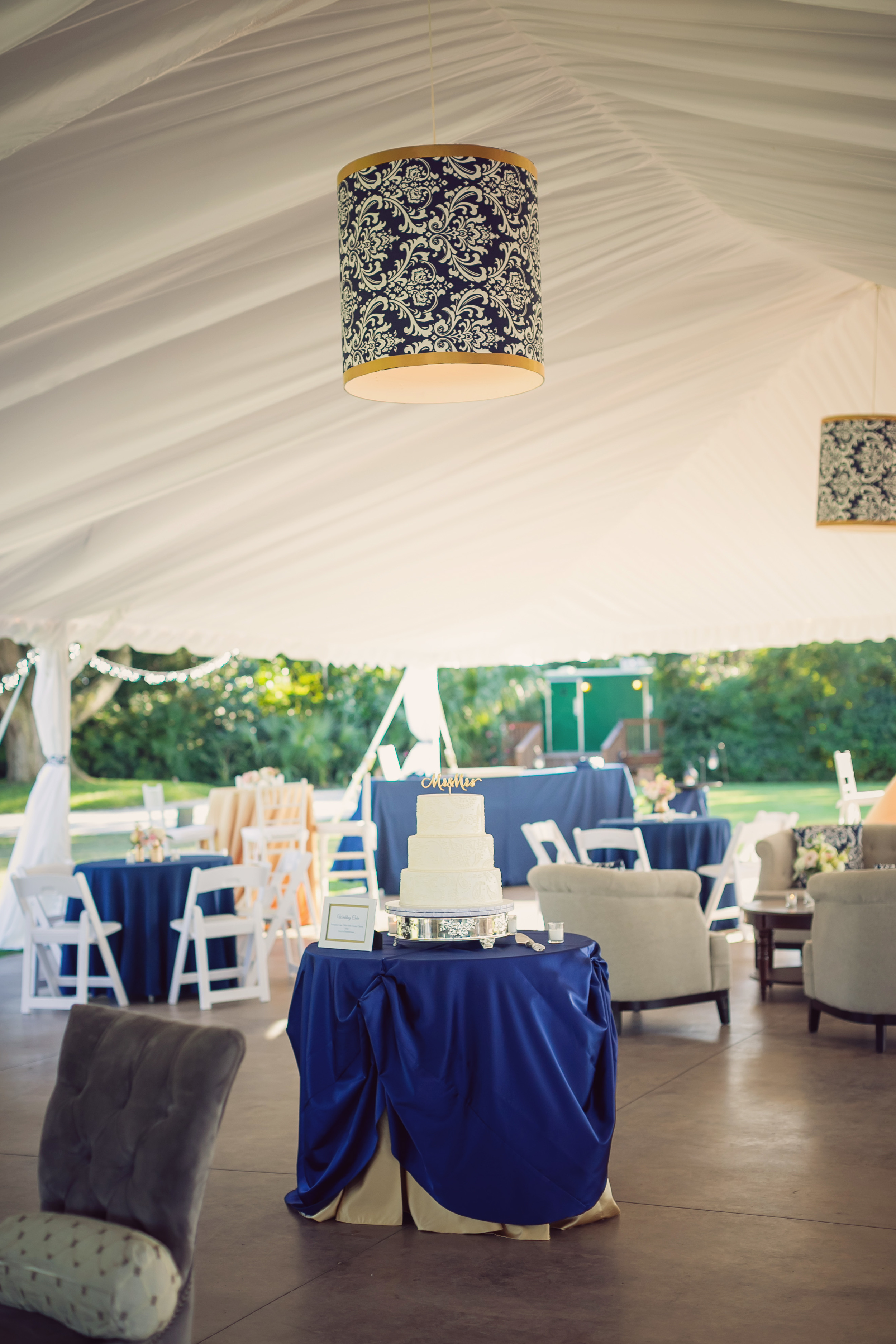 Gold and Navy Lighting Fixtures at Charleston wedding designed by Engaging Events