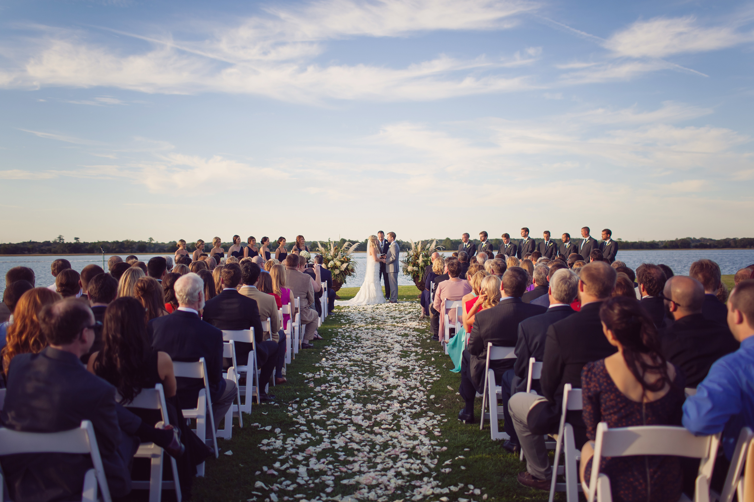 Outdoor wedding ceremony overlooking The Stono River at Charleston's The Island House