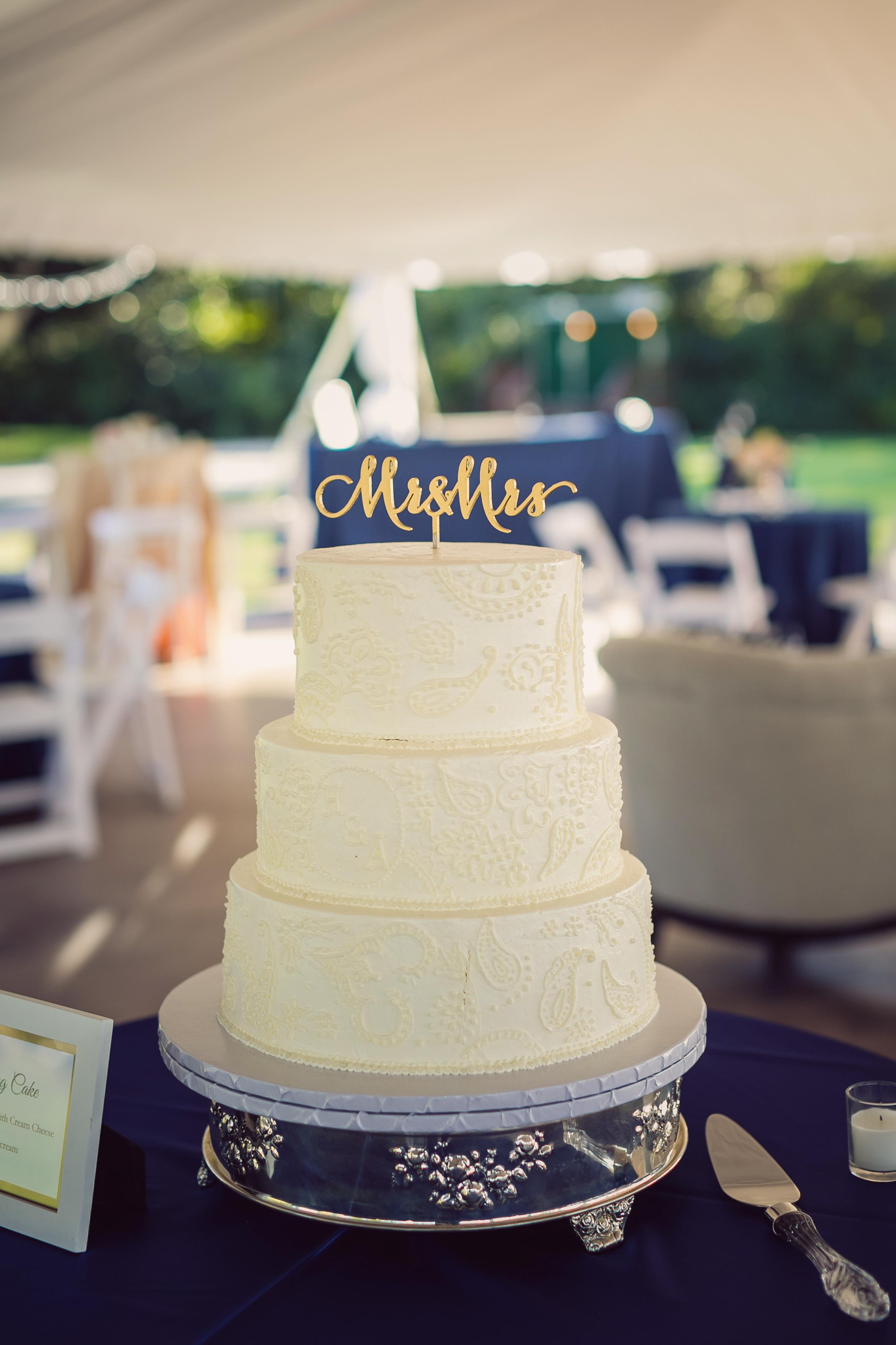 Three-tiered white Charleston wedding cake by Pawleys Island Bakery