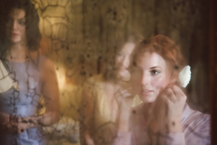 Bride prepping for Charleston wedding at The William Aiken House by amelia + dan photography