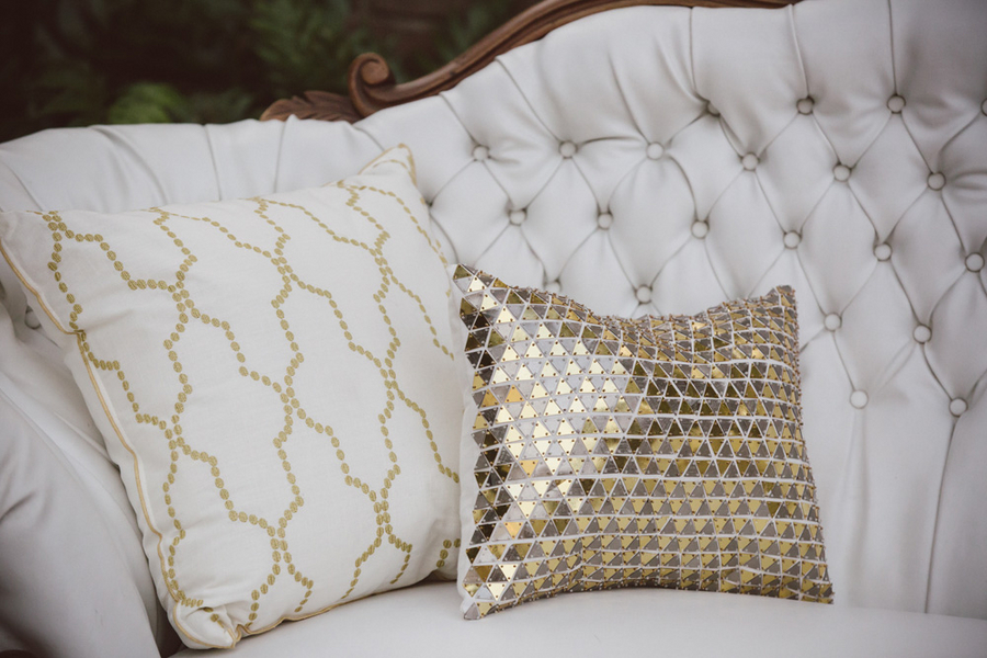 Gold sequined pillows and lounge furniture at Charleston wedding at The William Aiken House