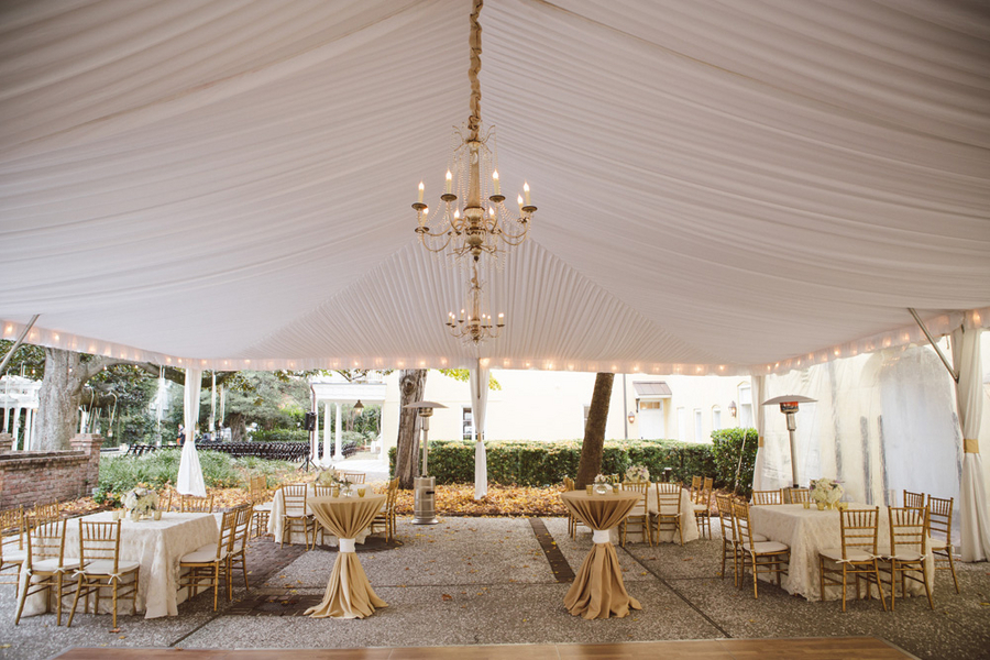 Outdoor tented gold and ivory Charleston wedding reception designed by Boutique Planning