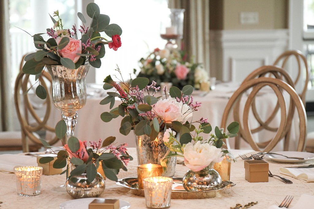 Blush colored flowers and eucalyptus centerpieces at Seabrook Island Club wedding by Miele Events Chelsea Paige Photography