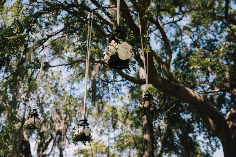 Hanging ceremony lanterns by Forget Me Nots in Charleston, SC