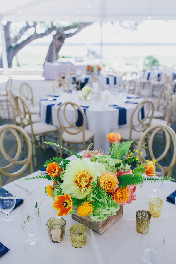 Bold orange and pink centerpieces by Branch Design Studio