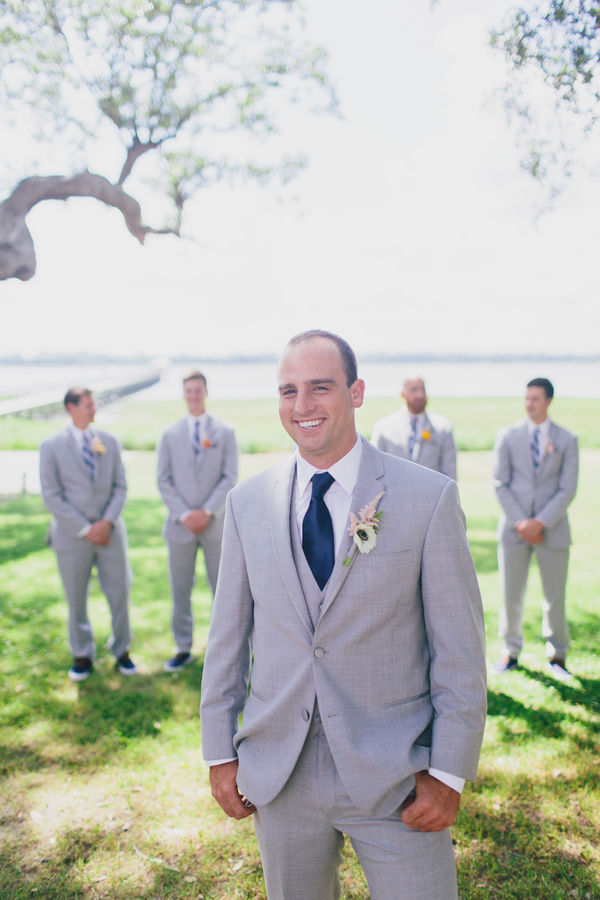 Groomsmen in light grey suits with navy ties at Charleston, South Carolina wedding