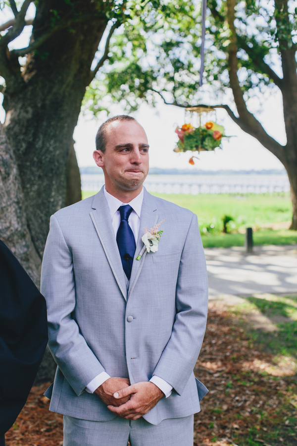 Groom seeing bride walk down the aisle at Lowndes Grove Plantation in Charleston, SC