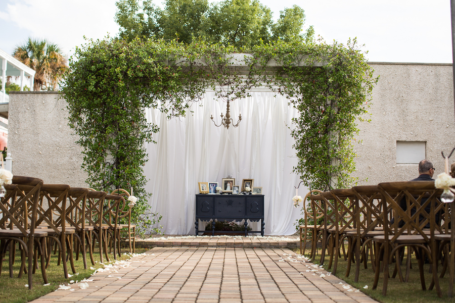 Outdoor wedding ceremony in the Tabby Garden at The Beaufort Inn